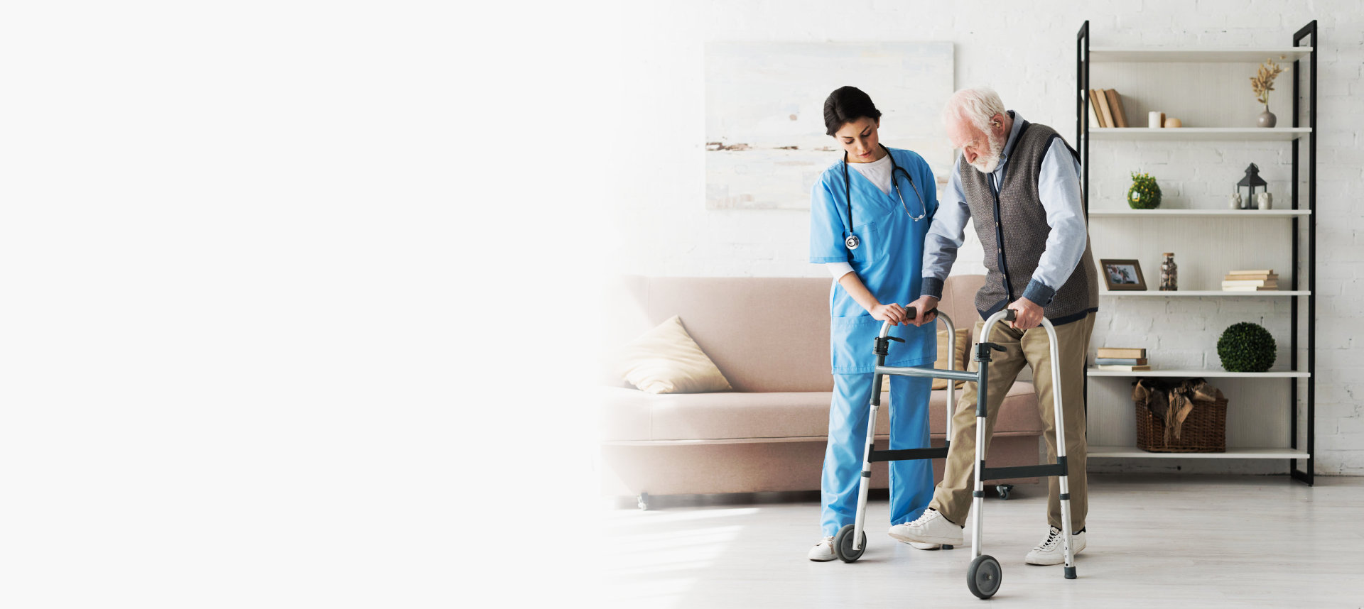 caregiver assisting elder man on using a walker